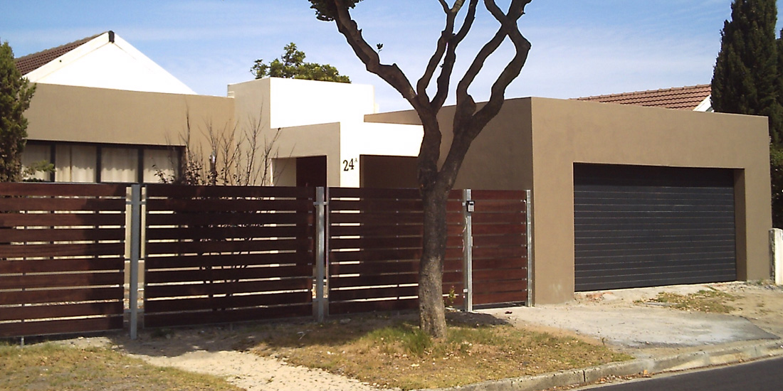 Charcoal horizontal slatted Aluzinc sectional door, and meranti fencing