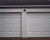 2 x Single white cardinal block fibreglass sectional doors