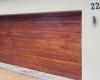 Double horizontal slatted meranti sectional door