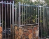 Galvanised steel pedestrian gate with fencing