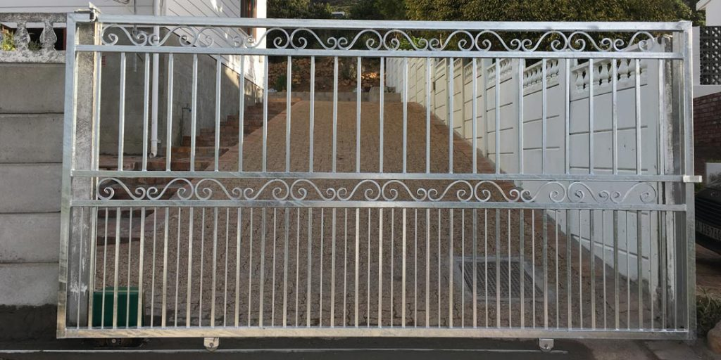 Steel sliding gate with doggy bars and s-scroll detail