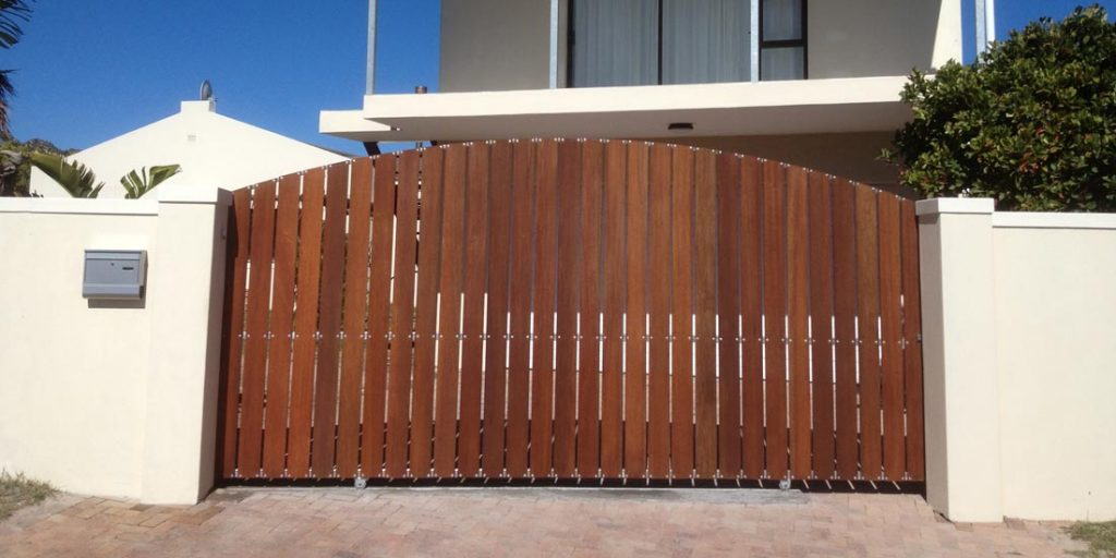 Vertical slatted arched meranti slidng gate