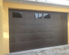 Double bronze raised & fielded aluzinc sectional door with square aluminium windows