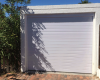 Single white horizontal slatted aluminium sectional door with false panel and painted treated pine styles