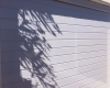 White horizontal slatted aluminium sectional door
