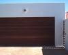 Horizontal slatted meranti sectional door - Caravan height