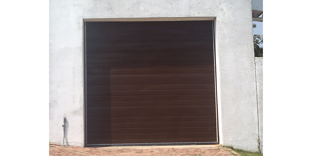 Single brown horizontal slatted fibreglass tip up door