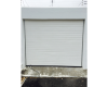 Single white horizontal slatted fibreglass tip up door